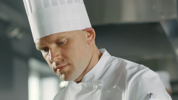 Close-up of a Chef Concentrated on Cooking Perfect Dish. Royalty-free stock video