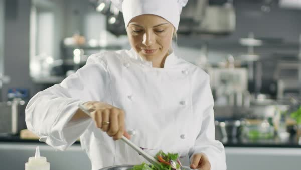 Female Chef Prepares Salad in a Big Modern Kitchen. Royalty-free stock video