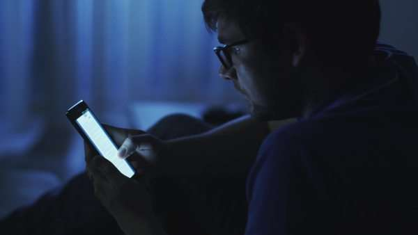 Man is browsing internet on phone at night Royalty-free stock video
