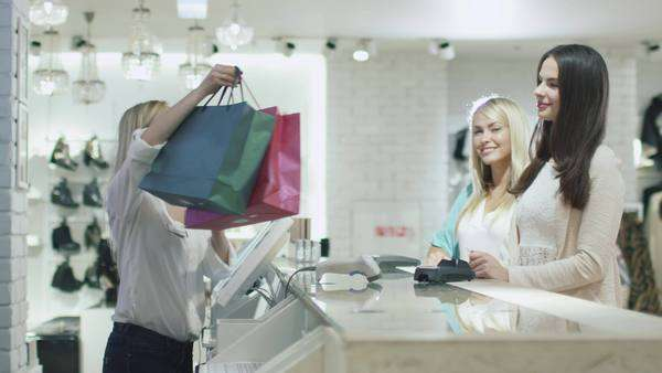 09c5fc096e6 Two cheerful young girls are buying clothes at a cash desk in a department  store. By Gorodenkoff. Stock Footage ...