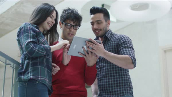 Group of young multi-ethnic students are using a tablet computer in an university. Royalty-free stock video