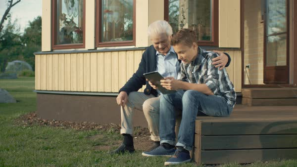 Grandson Teaches Grandfather How to Use tablet Tablet Computer Royalty-free stock video