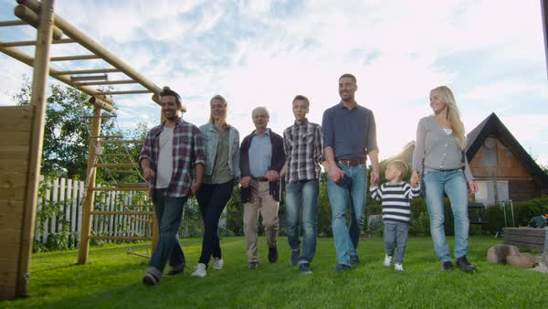 Family of Seven Walks on Camera. They're in the Backyard. Royalty-free stock video
