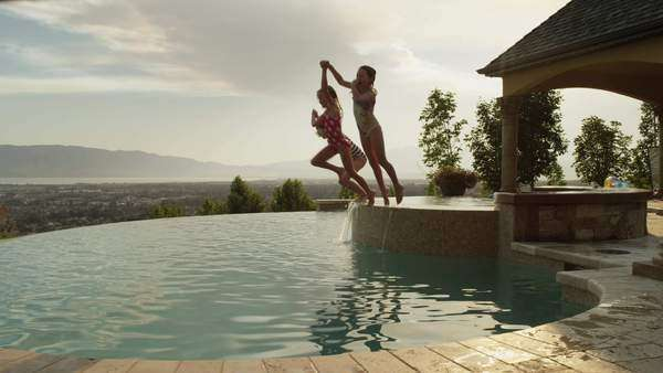 infinity pool united states.  United Panning Slow Motion Medium Shot Of Girls Jumping Into Infinity Pool  Cedar  Hills Utah United States  Stock Video Footage Dissolve And Infinity Pool