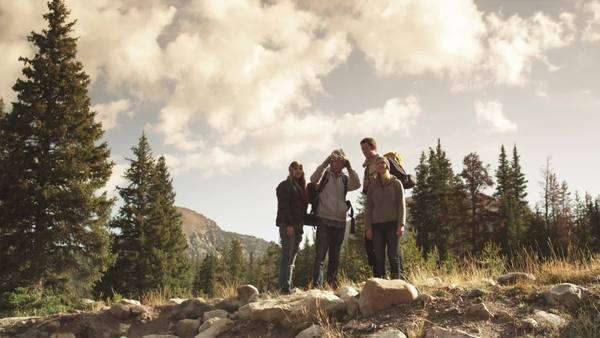 WS LA Hikers stopping to take photograph from ridge of hill, Uinta Mountains, Utah Royalty-free stock video