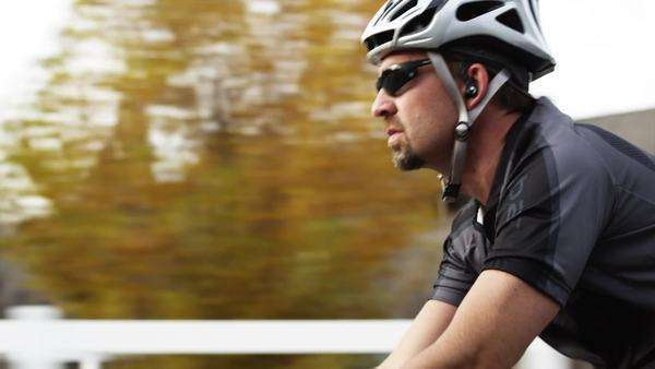 Medium tilt shot of man cycling in countryside, Royalty-free stock video