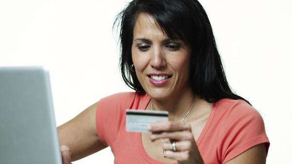 Medium shot of woman using laptop and credit card Royalty-free stock video