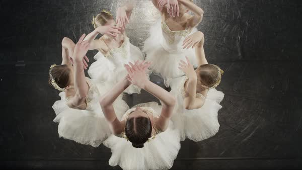Medium high angle shot of ballerinas dancing in circle Rights-managed stock video