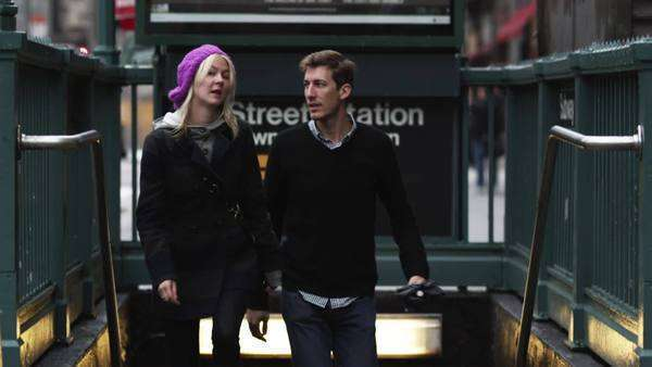 Medium shot tilt up young couple ascending subway station steps at Manhattan, New York City, New York, USA Rights-managed stock video