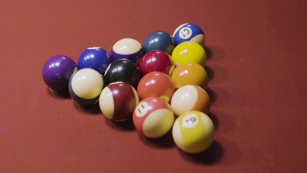 Hand Held Shot Of Billiard Balls Arranged In A Triangle On Pool Table