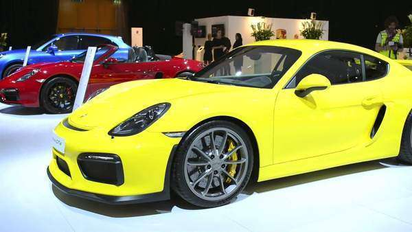 Yellow Porsche Cayman GT4 sports car front view at the D612_21_085