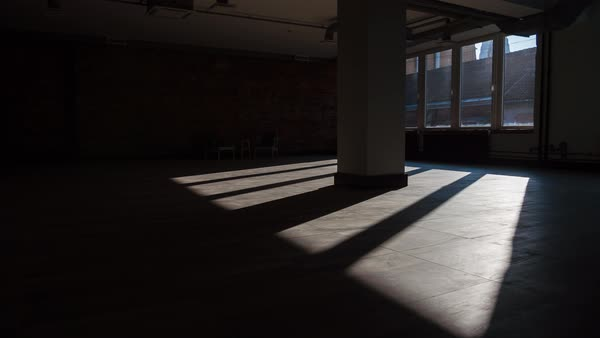 Timelapse Of Sun Rays Moving Over An Empty Rustic Office Space