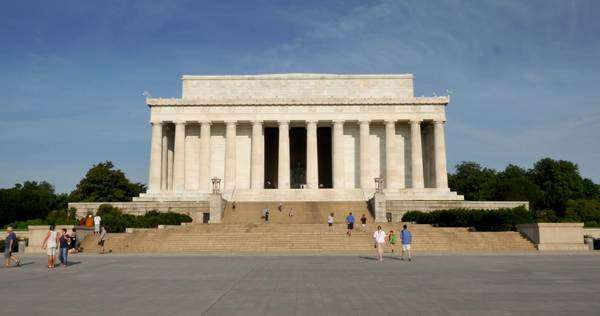 WASHINGTON, D.C. - July, 2015 - A pan right establishing shot of the Lincoln Memorial at dusk. Royalty-free stock video