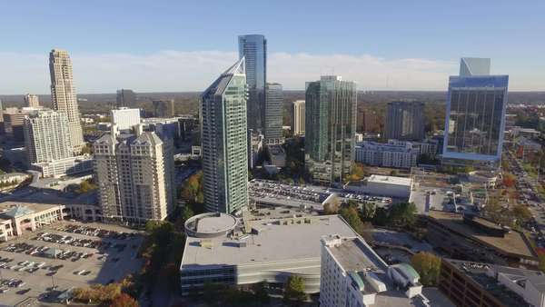A daytime aerial establishing shot of Buckhead, an affluent uptown district of Atlanta, Fulton County, Georgia. Royalty-free stock video
