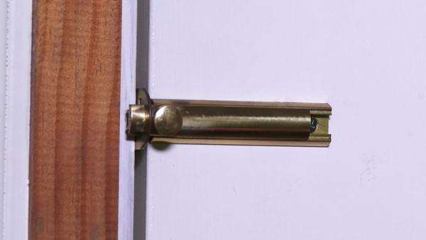 Locking and unlocking the deadbolt on a house's front door. Royalty-free stock video