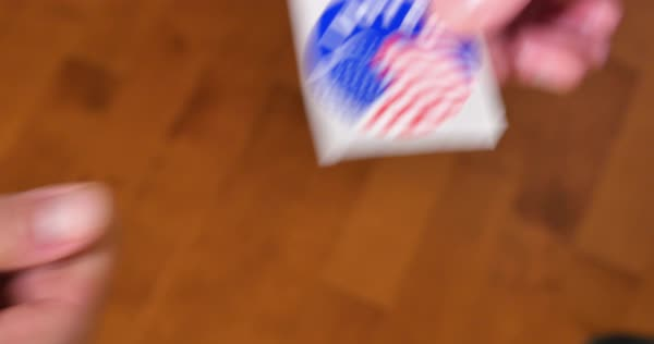 A man takes an I Voted sticker from someone else.  	 Royalty-free stock video