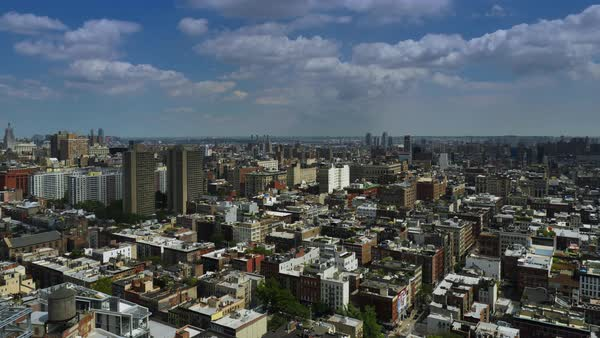 A summer day timelapse of puffy clouds passing over Midtown Manhattan.  	 Royalty-free stock video
