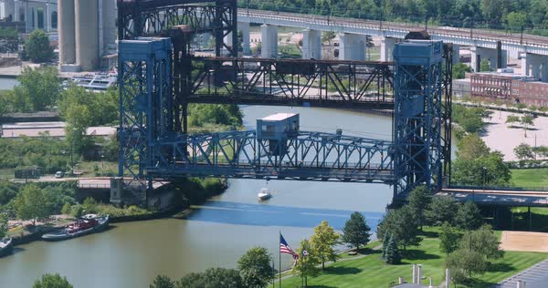 A time lapse view of a tour boat carrying tourists under a drawbridge on the Cuyahoga River in Cleveland.  	 Royalty-free stock video
