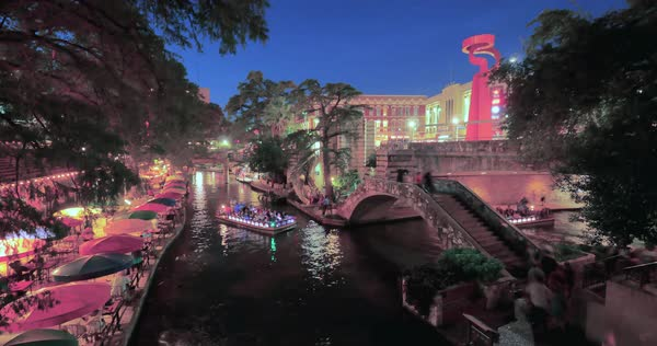 A day to night timelapse view over the famous river walk in downtown San Antonio, Texas.  	 Royalty-free stock video
