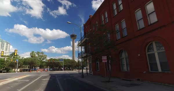 A driver's perspective on the streets of San Antonio, Texas with the Tower of the Americas in the distance.	 	 Royalty-free stock video