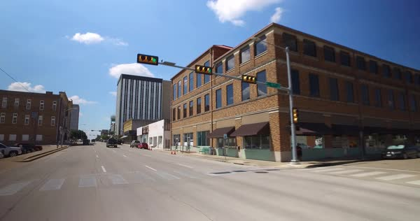 A driving perspective past various businesses in downtown Waco, Texas.  	 Royalty-free stock video
