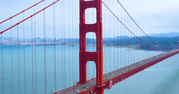 A static establishing shot of the city as seen through the Golden Gate Bridge on a foggy overcast day. Royalty-free stock video