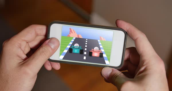 A person plays a retro 8-bit racing video game on a smartphone.    Royalty-free stock video