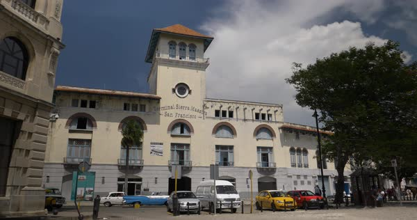 A daytime exterior establishing shot of the Terminal Sierra Maestra San Francisco on the shore of Havana, Cuba. Royalty-free stock video