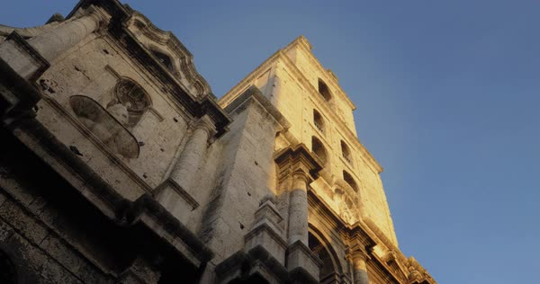 A low angle morning establishing shot of birds around the tower of Basilica San Francisco de Asis in the old town district of Havana, Cuba. Royalty-free stock video
