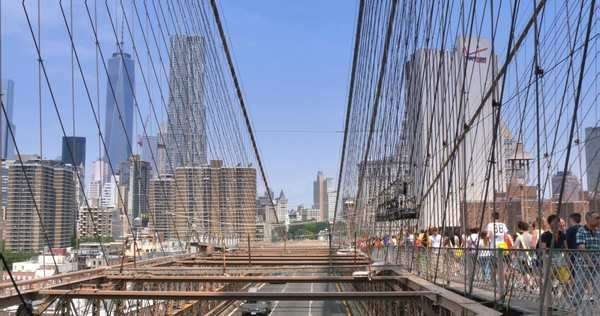 BROOKLYN, NY - Circa July, 2014 - Tourists and traffic pass over the Brooklyn Bridge. Royalty-free stock video
