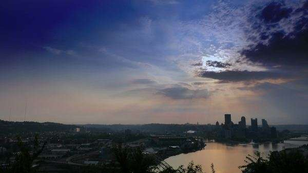 A dramatic wide shot timelapse sunrise over Pittsburgh, Pennsylvania Royalty-free stock video