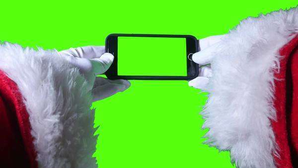 A close up shot of Santa Claus using a green screen smartphone. Royalty-free stock video