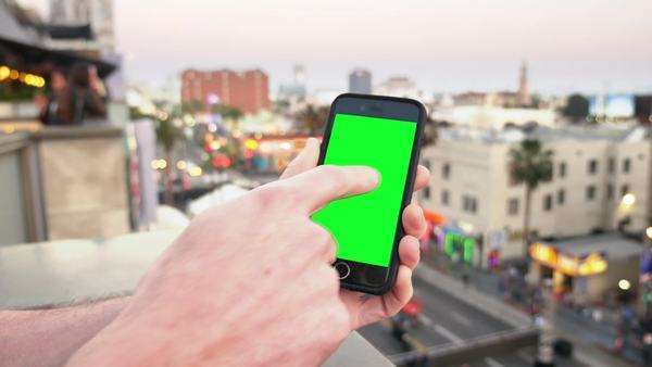 A man uses a green screen smart phone on the streets of Hollywood. Royalty-free stock video
