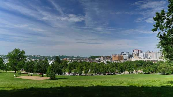 A wide angle establishing shot of Oakland and the city of Pittsburgh, as seen from Schenley Park. Royalty-free stock video