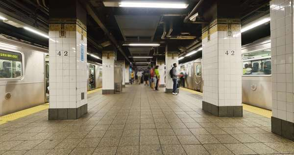 A timelapse of the hustle and bustle of people in the New York subway system. Royalty-free stock video