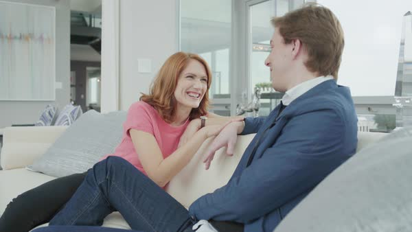 Medium shot of a woman talking to a man in a living room Royalty-free stock video