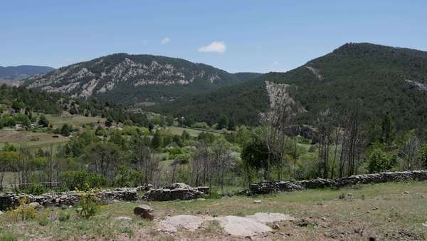Hills rise beyond a stone wall in the remote Sierra de Gudar. Royalty-free stock video
