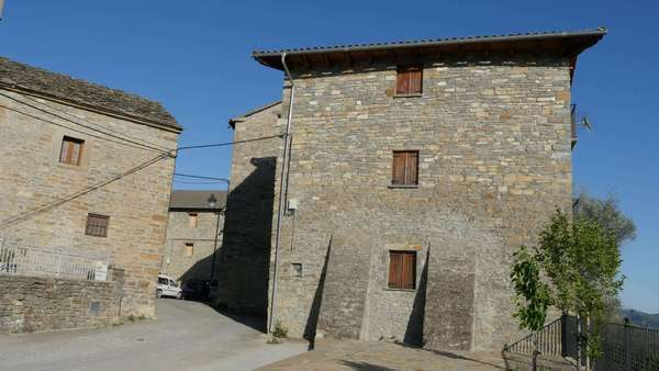 Stone houses stand near the entrance to Coscojuela de Sobrarbe in the Spanish Pyrenees. Royalty-free stock video