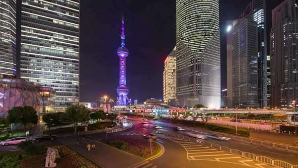 Pan busy Pudong city center and Shanghai Pearl Tower light show. Rights-managed stock video