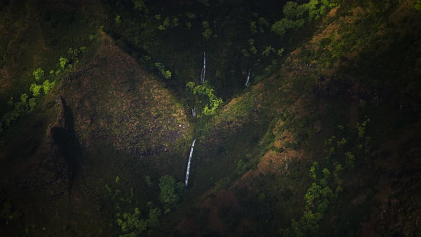 Kauai, Napali Coast, shadow moving waterfall timelapse. Rights-managed stock video