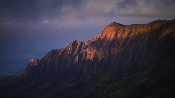 Kauai, Napali Coast,  sunset and foggy ridgeline timelapse. Rights-managed stock video