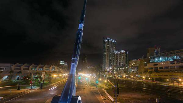 Timelapse dolly shot of San Diego Downtown bridge with city at night. Rights-managed stock video