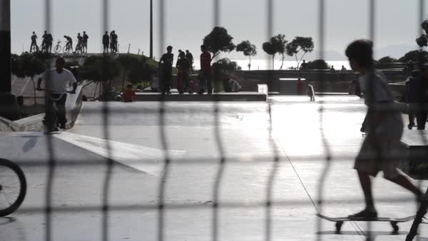 Wide shot of skaters behind a fence Royalty-free stock video