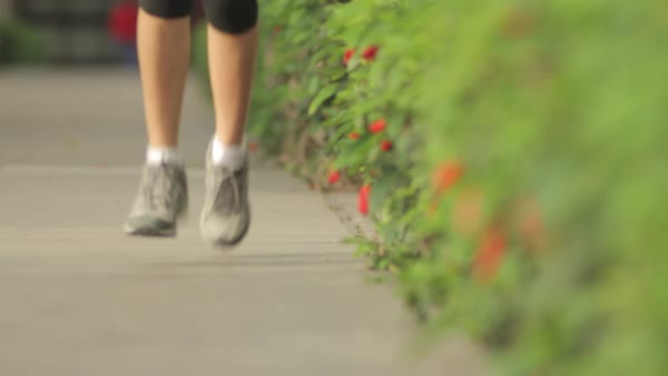 Close-up shot of woman running in next to bushes Royalty-free stock video