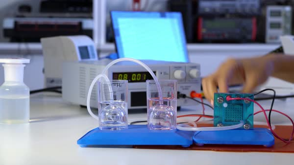 Student with experiment PEM proton exchange membrane reversible fuel-cell  stock footage