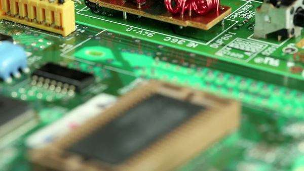 Microcircuit chip with electronic components  Close-up of micro circuit,  resistors and chips  Chips and resistors on green circuit board close up