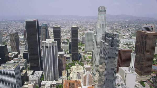 Aerial view of  Los Angeles cityscape and skyscrapers in California State.  Summer haze surrounds the buildings and horizon shot from helicopter. LA USA. Royalty-free stock video