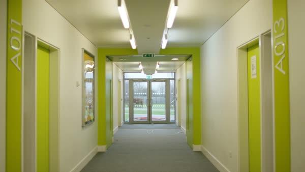 Interior View Of Empty Hallway In Modern School Building Stock