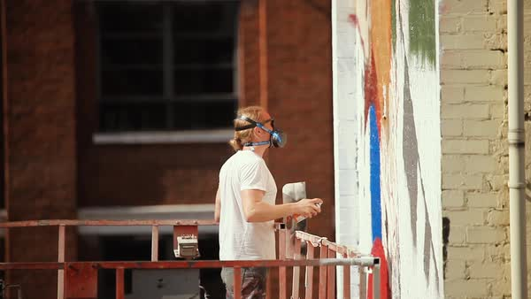 Medium shot of a man painting a mural Royalty-free stock video