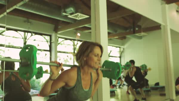 Medium shot of woman lifting weight in gym Royalty-free stock video